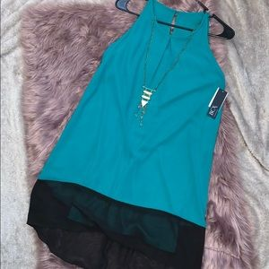 black and teal dress with gold necklace